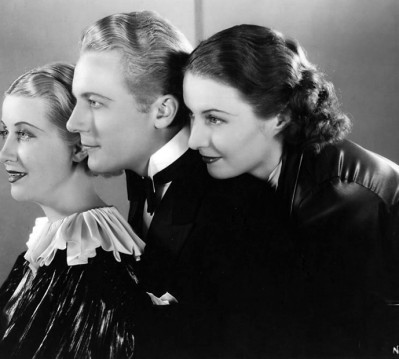 Genevieve Tobin, Gene Raymond and Barbara Stanwyck in THE WOMAN IN RED